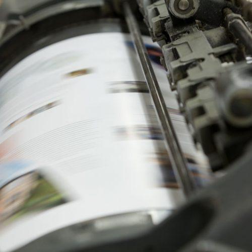 Printing press drum in motion
